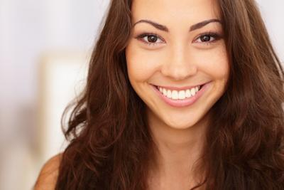 woman with dark hair smiling