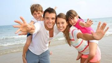 Family on Beach | Jensen Beach Dental