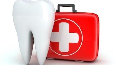 image of a tooth with a first aid kit